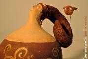 <h5>Donna di Bronzo</h5><p>Scultura in cartapesta con fischietto di argilla </p>