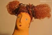 <h5>Donna Rame - Particolare</h5><p>Inserisci la Descrizione</p>