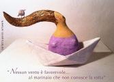 <h5>Omaggio al Caba</h5><p>Scultura di donna su barchetta (cartapesta) con fischietto civetta in terracotta</p>