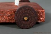 <h5>La storia, la memoria - Dettaglio ruote in legno</h5><p>Scultura di papier-maché selezionata alla biennale di Santorini 2012</p>